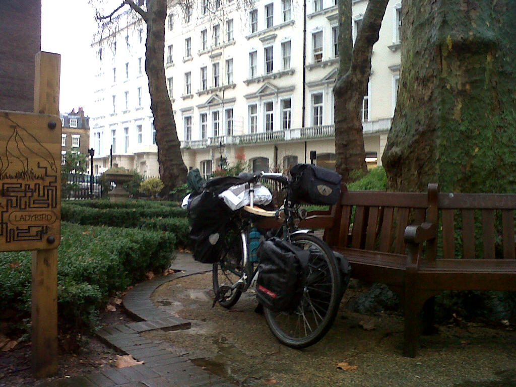 Phil's bike, loaded with scythe equipment, in Norfolk Square, London