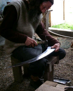 Phil demonstrating free hand peening with a bar peen anvil
