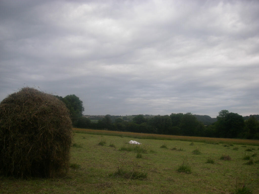 A hay rack and a heavy threatening looking sky